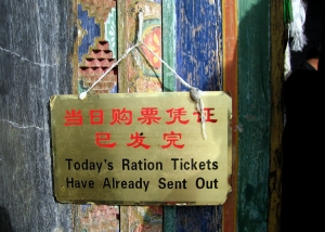 Sign hanging on the front door of the Potala Palace