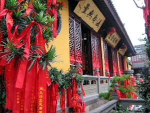 Red cloth tied to the lattice of the Jade Buddha Temple doors in Shanghai, China