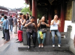 Chinese tourists eating noodles in Shanghai Old Town, China
