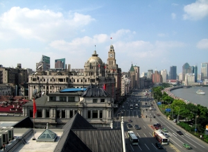 View east along the Bund to the Peace Hotel - note the thousands of tourists crowded along the promenade