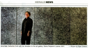 Catherine Croll and the five panel Gloria Petyarre - Newcastle Herald
